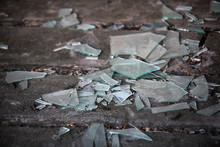 Shards Of Broken Glass On The Old Wooden Floor