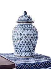 Antique Thai Porcelain Jar Placed On A Table Covered With Cotton On White Background