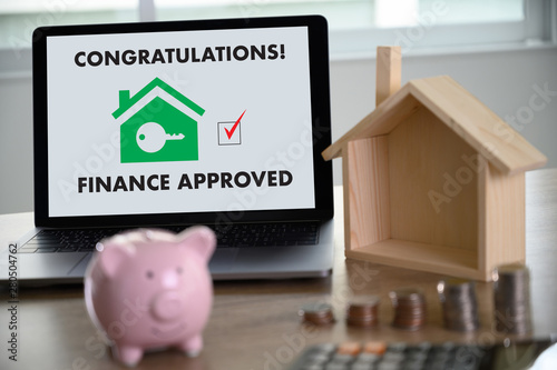 Fototapeta Mortgage Loan approval on mobile phone in a house contract form with approved  home ownership obraz