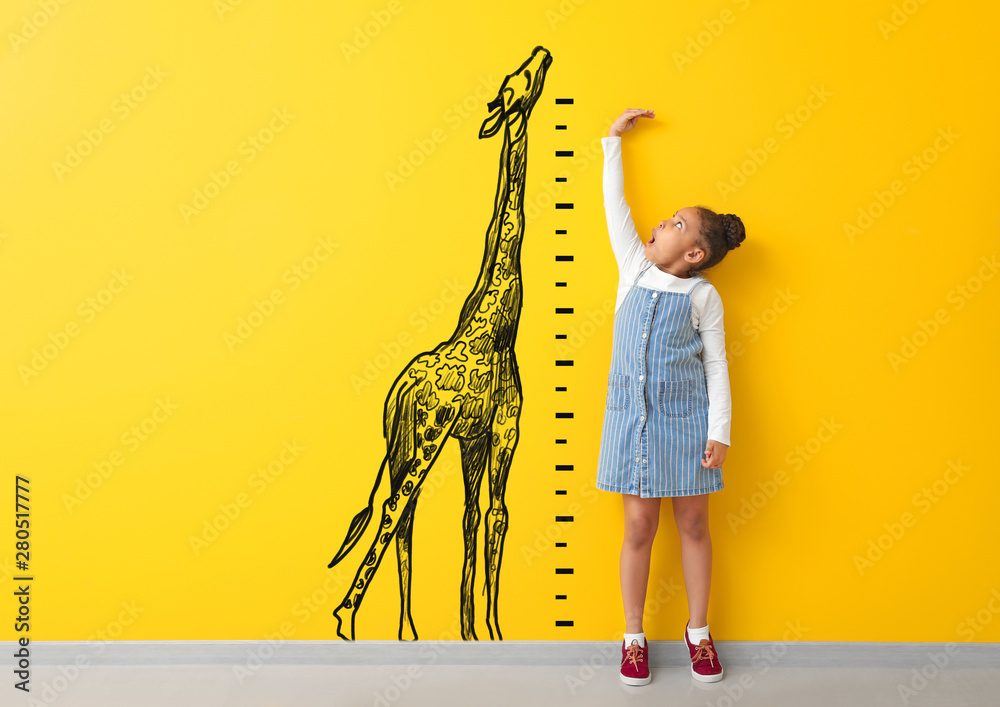 Fototapety, obrazy: Surprised African-American girl measuring height near color wall with drawn giraffe