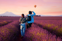 Asian Couple Travel In Lavende...