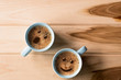 canvas print picture - froth milk foam smiles in a cup of coffee in morning.