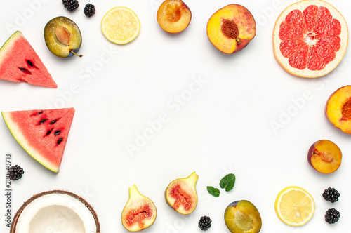 Tropical Summer Fruit Concept. Creative layout made of fresh ripe watermelon, peach, plum, fig, lemon, grapefruit and mint leaves on white background. Flat lay, top view, copy space. Food background - 280540718