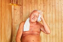 Senior Man Sweats In The Steam Sauna