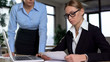 Angry boss scolding incompetent trainee, dissatisfied with mistakes in work