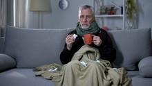 Ill Pensioner Sneezing And Holding Hot Beverage, Treating Influenza, Epidemic