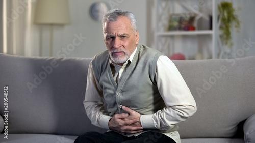 Fotografía  Elder male suffering stomach ache, sharp cramps in upper abdomen, indigestion