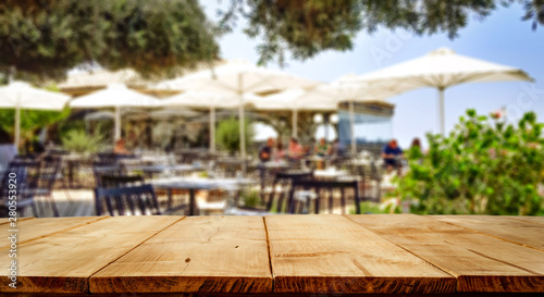 Table background in a outdoor restaurant view. Empty space for your decoration and advertising products.