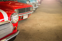 Close-up Of Headlights Of Red Vintage Car In A Row.Retro Car , Classic Car, Old Car.