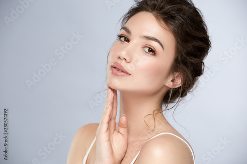fresh woman face with glossy lipstic and light make-up looking to camera Fototapeta