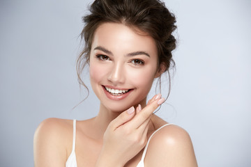 model with perfect smile and beautiful face isolated on grey