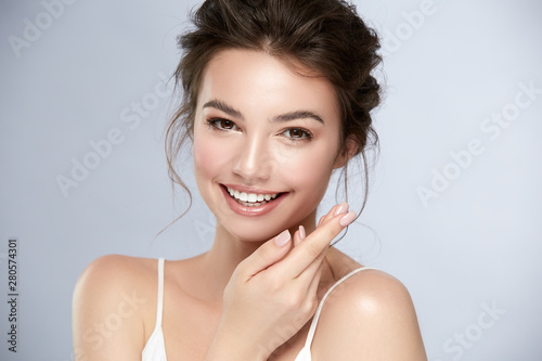 Photo model with perfect smile and beautiful face isolated on grey