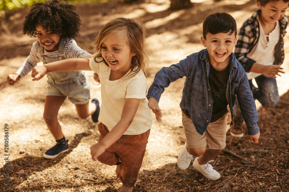 Fototapeta Children playing together in forest