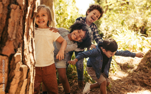 Group of children playing hide and seek - 280586309