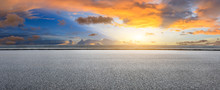 Asphalt Highway And Beautiful Clouds Landscape At Sunset