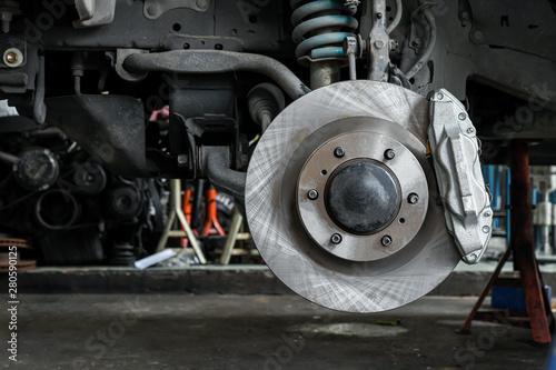 Fotografia, Obraz New car brake system replacement, brake disc, brake caliper.