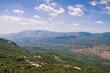 Beautiful mountain landscape on sunny summer day. Montenegro, Dinaric Alps, view of Bjelopavlici plain near Ostrog monastery