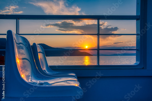 magical sunset over the ferry boat on the island of thassos in greece Fototapete