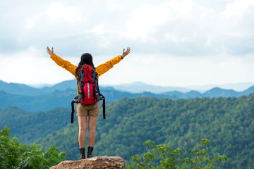 Fototapeta Do szkoły Women hiker or traveler with backpack adventure feeling victorious facing on the mountain, outdoor for education nature on vacation. Travel and Lifestyle Concept