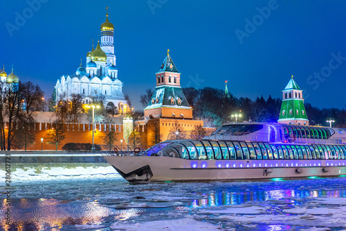 Moscow. Russia. Kremlin. Moscow river in winter. Christmas. New year. Kremlin wall. Decorated evening city. Winter holidays in Russia. Boat trips on the Moscow river. Temples Of The Kremlin