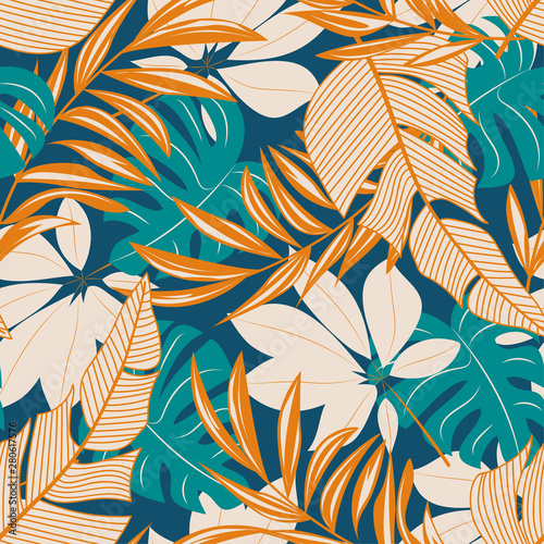 Leinwand Poster Abstract seamless pattern with colorful tropical leaves and flowers on a pastel background