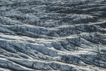 An Aerial View Of Svínafellsjökull Glacier. The Black Lines Or Striations In The Ice Are From Ash From Past Volcanic Eruptions.