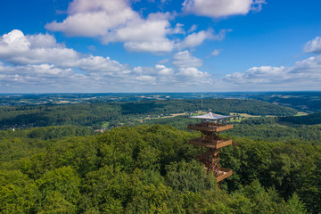 Aerial view of Wiezyca. Observation Tower. Kashubian Landscape Park. Kaszuby. Poland. Photo made by drone from above. Bird eye view.