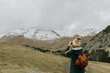 Woman With Binoculars In The Mountains