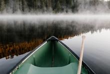 Green Canoe On Foggy Lake