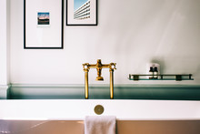 Beautiful Deluxe Bathroom Detail With Framed Photos Above Bathtub