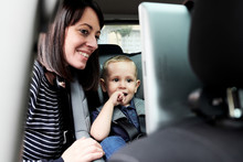 Woman With Boy Watching Tablet...
