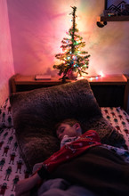 Direct View Of Boy Sleeping The Night Before Christmas