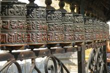 CLOSE UP: Beautiful Metal Prayer Wheels Are Illuminated By The Bright Sunshine