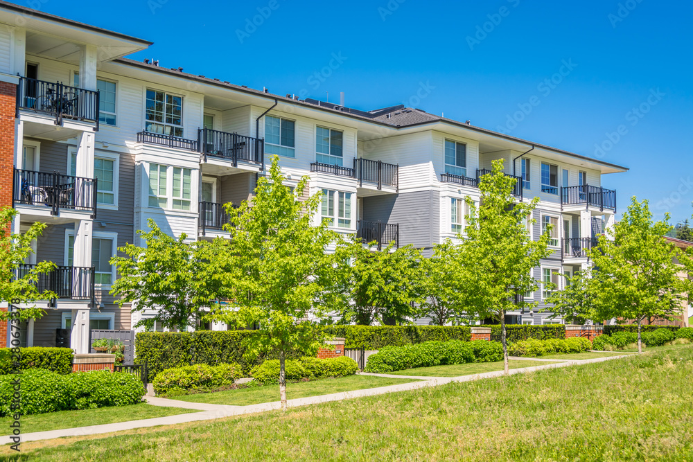 Fototapety, obrazy: Luxury apartment building with green lawn in front