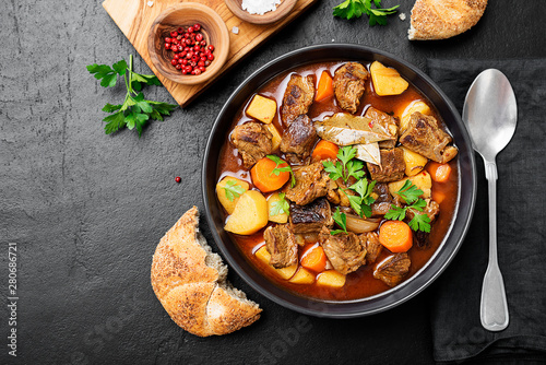 Fototapeta Beef meat  stewed with potatoes, carrots and spices (hungarian goulash). obraz