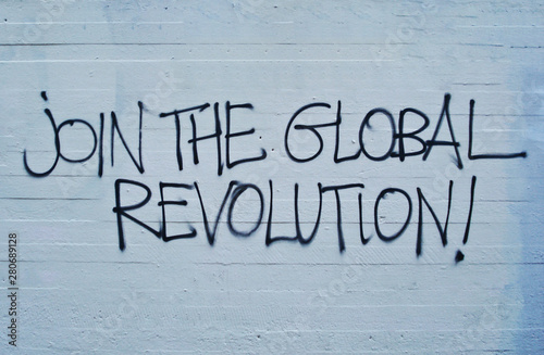 Join the global revolution written on the wall Canvas Print