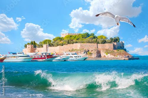 Fototapeta Pigeon Island with a Pirate castle Kusadasi harbor - Kusadasi, Turkey