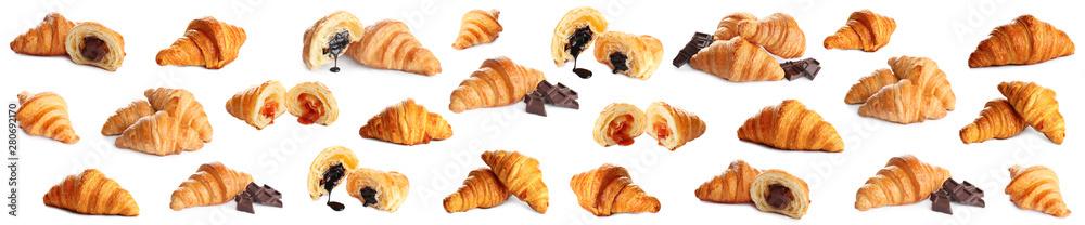 Fotografia Set of delicious fresh baked croissants on white background
