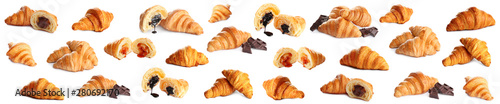 Photo Set of delicious fresh baked croissants on white background