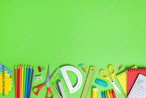School supplies on green background. Back to school concept.