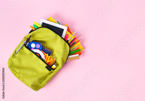 School backpack isolated on pink background. Wallpaper Mural