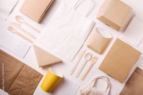 Obraz Top view and flat lay concept of Eco friendly, kraft, disposable, recyclable tableware. Paper food boxes, dishes on white background - fototapety do salonu