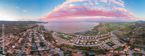 The incredible sunset over the bay of L'Ampolla and Deltebre, Catalonia, Spain. Drone aerial panorama
