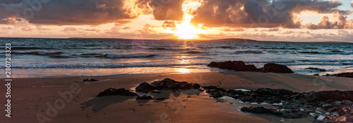 Fototapeta Golden light beach sunset reflection, Atlantic ocean on the west coast of Ireland obraz