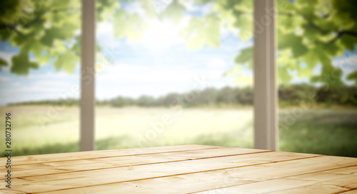 Wooden desk of free space and blurred background of window space