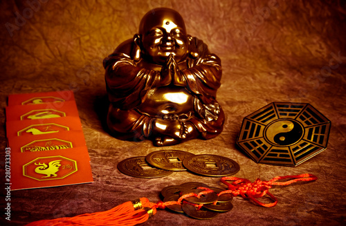 Fotografía Oriental belief with happy Buddha, coins of good luck, yin yang and chinese zodi