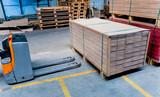 Fototapeta Kawa jest smaczna - Forklift loader in storage warehouse ship yard. Distribution products. Delivery. Logistics. Transportation.