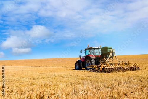 Fotografie, Obraz farmer plowing fields after summer grain harvest