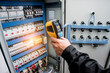 canvas print picture - Technician use infrared thermal imaging camera to check temperature at fuse-box