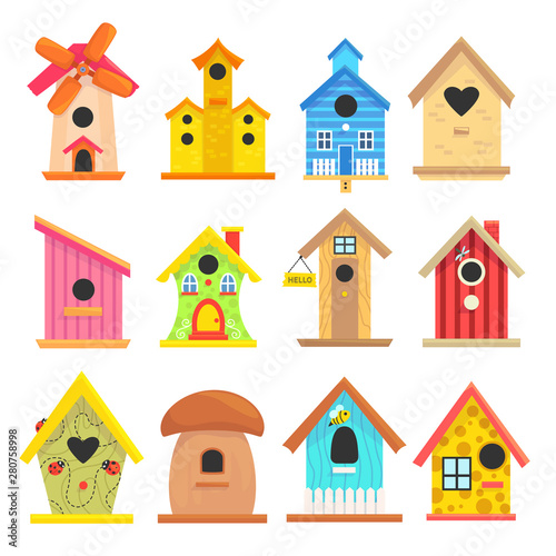 Fotografiet Wooden birdhouse set, colorful garden outdoor decoration